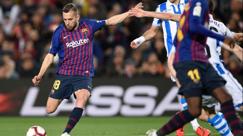The Catalans will be crowned champions for the 26th time if they beat Alaves on Tuesday and Levante next Saturday. (Photo: AFP)