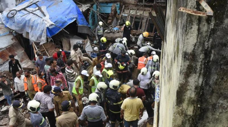 At least two died and two persons are feared trapped after a portion of a three-storey building in Nagpada area of South Mumbai collapsed. (Photo- Twitter)