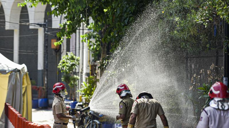 Firefighters spray disinfectants at a locality near Nizamuddin mosque during a nationwide lockdown in the wake of coronavirus pandemic, in New Delhi. PTI photo