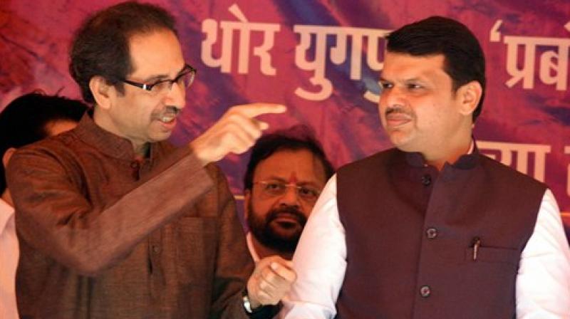 Maharashtra CM Devendra Fadnavis and Shiv Sena President Uddhav Thackeray (Photo: AP)