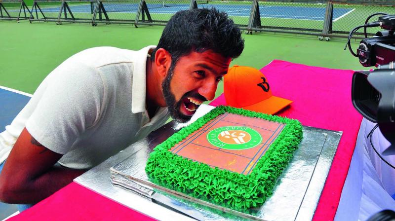 Rohan Bopanna strikes a pose with his victory cake at the KSLTA in Bengaluru. (Photo:  Satish B.)