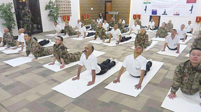 Indian Army and Peoples Liberation Army soldiers  perform yoga at Daulat Beg Oldie border post.