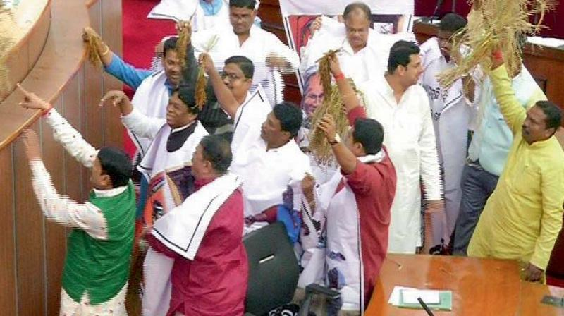 Congress MLAs protest inside the House on Tuesday. (Photo: Asian Age)