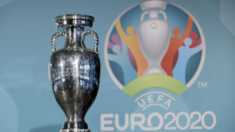 File photo the Euro soccer championships trophy in front of the logo. AP Photo