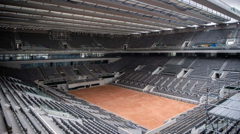 File photo of construction work of the newly built roof of the Philippe Chatrier center court is at Roland Garros stadium in Paris. AP File Photo