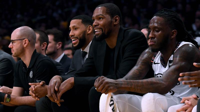 Kevin Durant (2nd right) of the Brooklyn Nets was mostly on the bench throught the just postponed season. AFP Photo