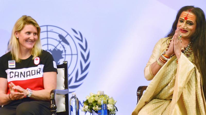 Four-time Canadian Olympic gold medalist Hayley Wickenheiser (left) at the United Nations Young Changemakers Conclave, in New Delhi. Also seen is Laxmi Narayan Tripathi, transgender rights activist. PTI Photo