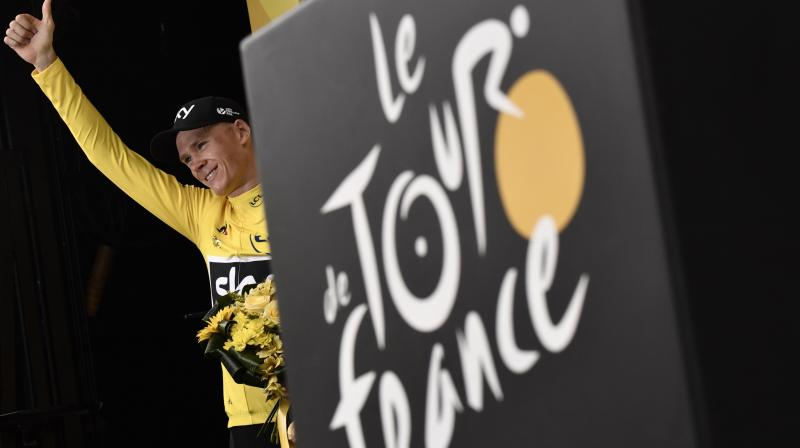 Great Britain's Christopher Froome thumbs up as he celebrates his overall leader yellow jersey on the podium at the end of the 181,5 km ninth stage of the 104th edition of the Tour de France cycling race between Nantua and Chambery in 2017. AFP file photo