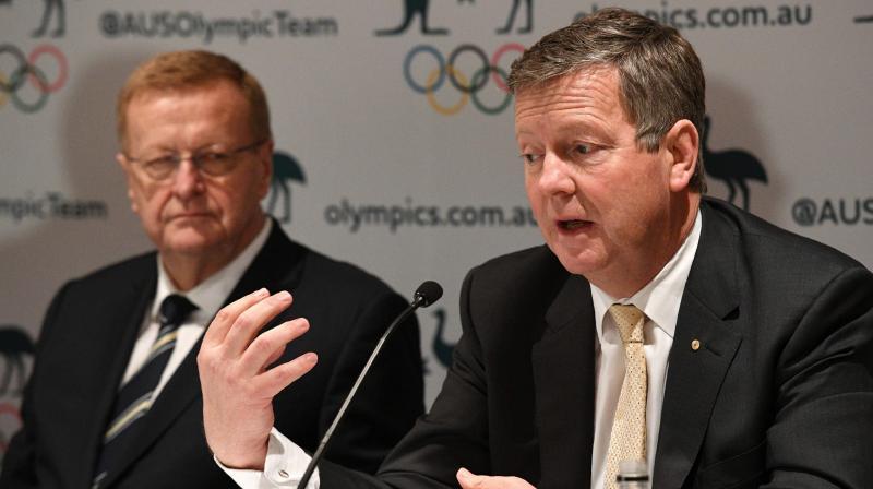 Australian Olympic Committee (AOC) chief executive officer Matt Carroll (R) speaks as AOC president John Coates looks on. AFP Photo