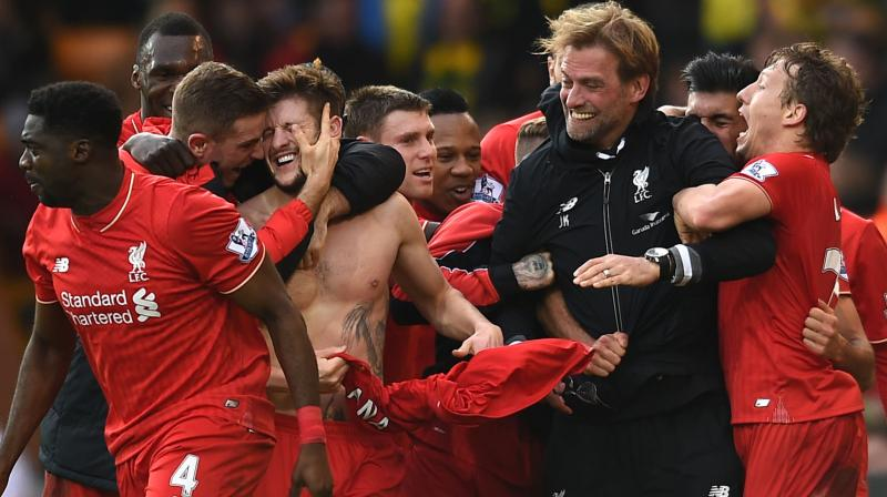 ONE WITH PLAYERS: Liverpool manager Jurgen Klop celebrates Adam Lallana's (third left) goal with other players in the English Premier League match against Norwich City at Carrow Road, Norwich, England, on Jan. 23. AP Photo