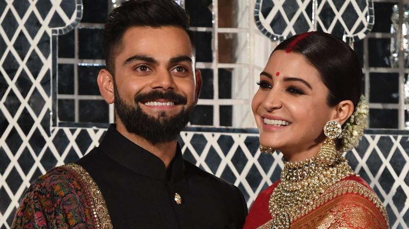Virat Kohli and Anushka Sharma. AFP Photo