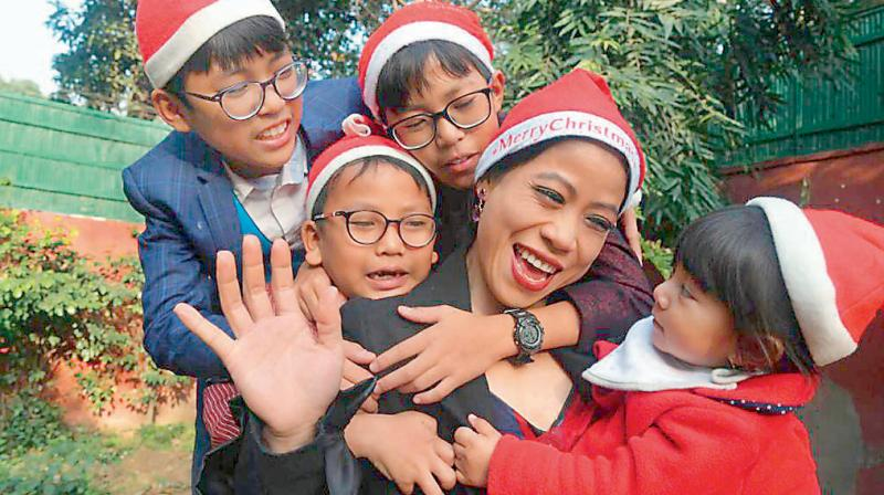 Mary Kom with her children during last Christmas. DC File Photo