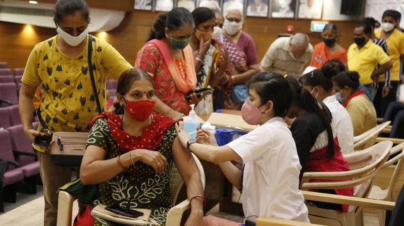 A health worker administers the vaccine for COVID-19 at Gujarat University in Ahmedabad. (Photo: PTI)