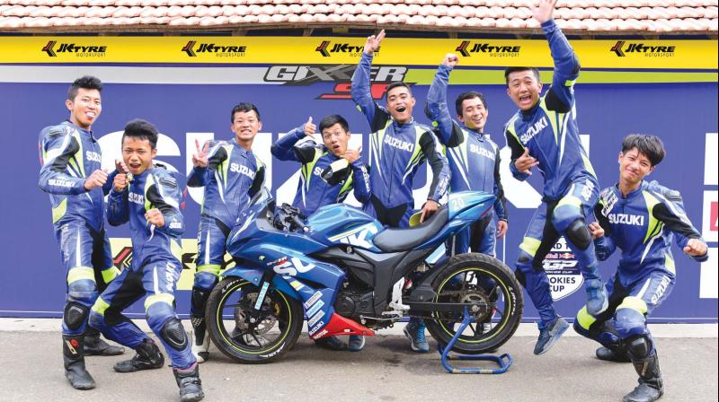 Riders from Aizawl strike a happy pose.