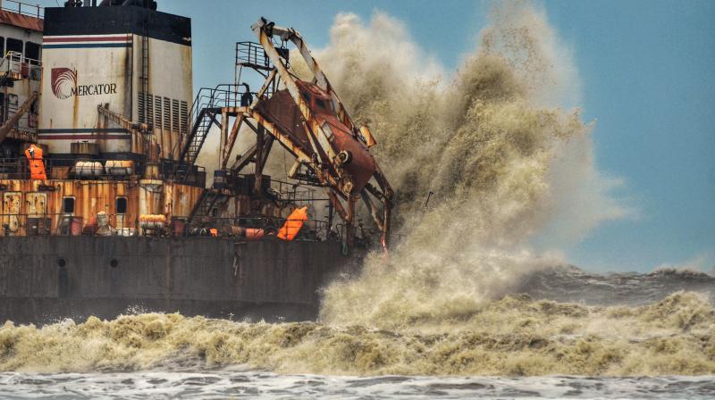 High sea waves due to cyclone Tauktae hit Bhagavathi Prem Sinken Dredger, at Surathkal Beach near Mangaluru, Sunday, May 16, 2021. (PTI)