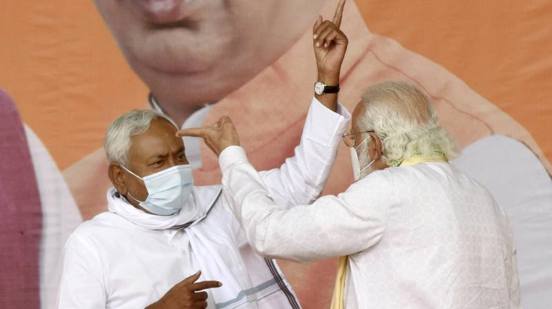 Prime Minister Narendra Modi with Bihar Chief Minister and Janata Dal (United) President Nitish Kumar during an election rally, in Sasaram. (PTI)
