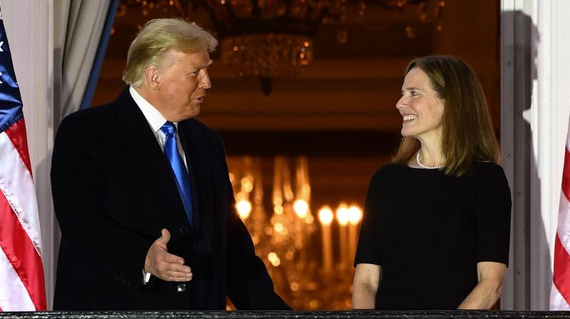 US President Donald Trump (L) stands with Judge Amy Coney Barrett after she was sworn in as a US Supreme Court Associate Justice during a ceremony on the South Lawn of the White House October 26, 2020, in Washington, DC. (AFP)