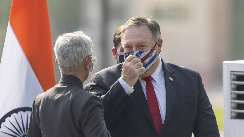 U.S. Secretary of State Mike Pompeo speaks with Indian Foreign Minister Subrahmanyam Jaishankar after attending a joint press conference at Hyderabad House in New Delhi, India. (AP)