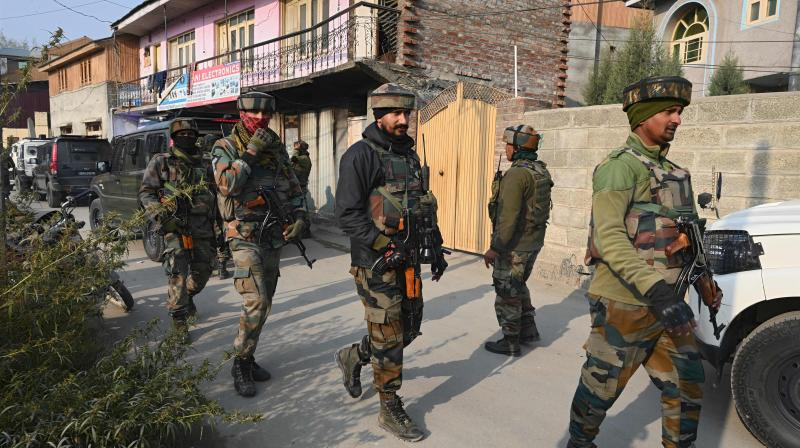 Indian army soldiers are seen near the site of a gunbattle between suspected militants and government security forces at Moachwah in Chadoora area of Budgam district on the outskirts of Srinagar on October 28, 2020. (AFP)