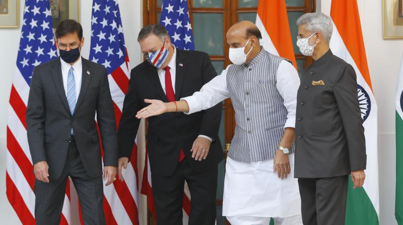 Indian Defence Minister Rajnath Singh, second right, gestures towards U.S. Secretary of State Mike Pompeo, second left, and Secretary of Defence Mark Esper, left, with Indian Foreign Minister Subrahmanyam Jaishankar, right, standing beside him, ahead of their meeting at Hyderabad House in New Delhi, India, Tuesday, Oct. 27, 2020.(AP)