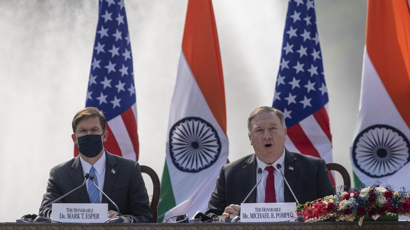 U.S. Secretary of State Mike Pompeo, right, speaks with Secretary of Defence Mark Esper seated beside him during a joint press conference with their Indian counterparts at Hyderabad House in New Delhi, India, Tuesday, Oct. 27, 2020. In talks on Tuesday with their Indian counterparts, Pompeo and Esper are to sign an agreement expanding military satellite information sharing and highlight strategic cooperation between Washington and New Delhi with an eye toward countering China. (AP)