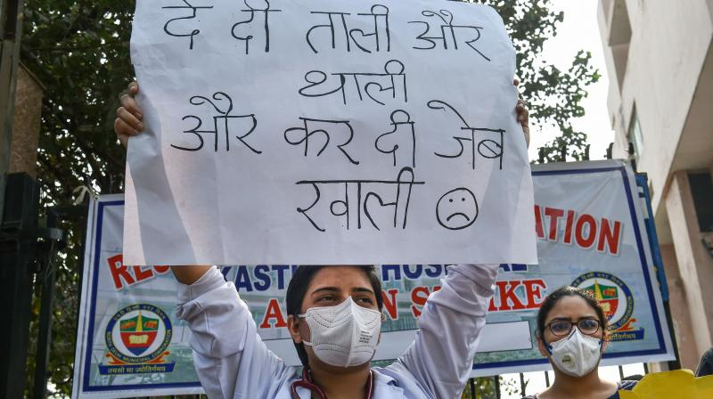 Resident doctors of Kasturba Hospital demonstrate over non-payment of their pending salaries by North Delhi Municipal Corporation, in New Delhi, Tuesday, Oct. 27, 2020. (PTI )