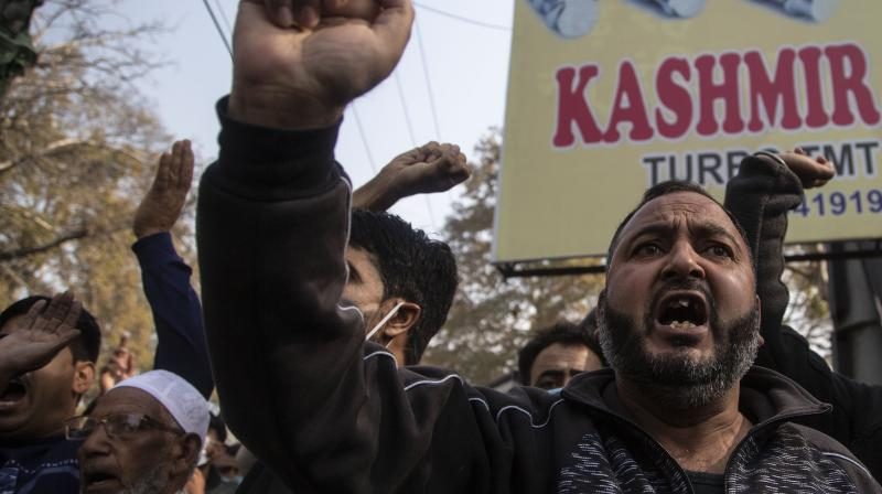 Activists of Peoples Democratic party (PDP) protesting against India's new land laws that allows any Indian citizen to buy land in the disputed region shout slogans in Srinagar, Indian controlled Kashmir, Thursday, Oct. 29, 2020. Until last year, Indians were not allowed to buy property in the region. But in August 2019, Prime Minister Narendra Modi's government scrapped the disputed region's special status, annulled its separate constitution, split the region into two federal territories. (AP)