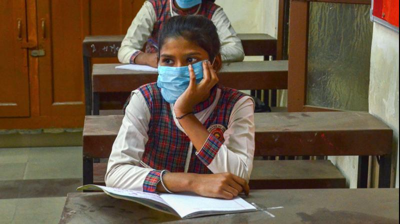 Students wearing face masks attend a class at a school that was reopened after closure for months owing to coronavirus pandemic, in Amritsar, Thursday, Oct. 22, 2020. Schools are being opened as per guidelines issued in Unlock. 5. (PTI)