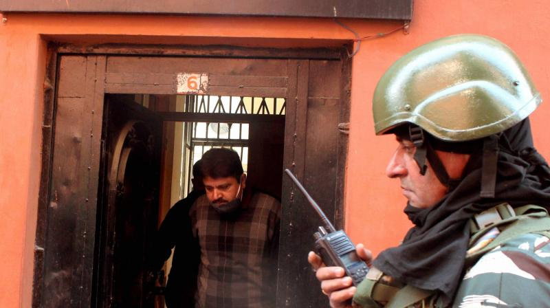 National Investigation Agency (NIA) officials come out of the Greater Kashmir office after conducting a raid, at Press Colony in Srinagar, Wednesday, Oct. 28, 2020. (PTI)