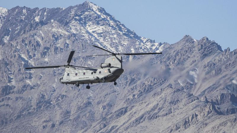 Indian Air Force (IAF) Chinook helicopter flies amid the prolonged India-China stand off in the Ladakh region, in Leh, Thursday, Oct. 29, 2020. (PTI)