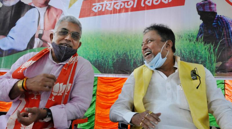 BJP National Vice-President Mukul Roy with party's West Bengal President and Lok Sabha MP Dilip Ghosh (L) during party's core committee meeting, in Kolkata, Wednesday, Oct. 28, 2020. (PTI)