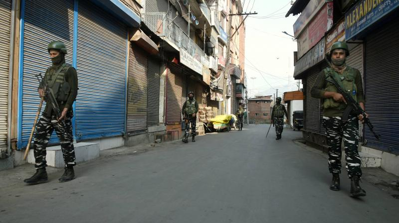 Security personnel patrol at a closed market during a strike called by the Hurriyat Conference (APHC) against the new land laws notified by the Centre for Jammu and Kashmir, in Srinagar, Saturday, Oct. 31, 2020. (PT)
