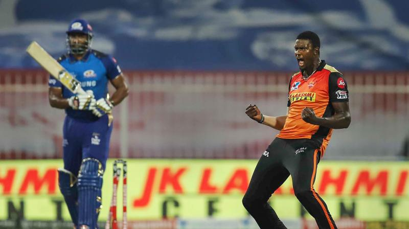 Jason Holder of Sunrisers Hyderabad celebrates the wicket of Kieron Pollard of Mumbai Indians during Indian Premier League (IPL ) cricket match in Sharjah, United Arab Emirates, Tuesday, Nov. 3, 2020. (PTI)