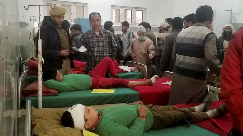 Children undergo treatment after an alleged unprovoked ceasefire violation by Pakistan in the Sawjian area of Poonch district, in Poonch district, Friday, Nov. 13, 2020. (PTI