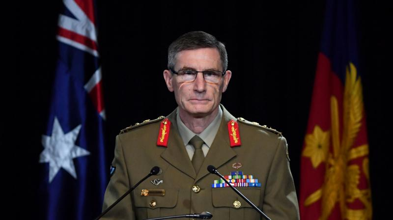 Chief of the Australian Defence Force (ADF) General Angus Campbell delivers the findings from the Inspector-General of the Australian Defence Force Afghanistan Inquiry, in Canberra on November 19, 2020. (AFP)