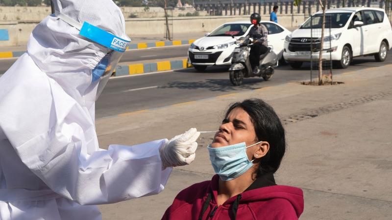 A health worker takes a swab from a woman for a Rapid Antigen Test (RAT) Covid-19 coronavirus tests in Ahmedabad on November 23, 2020. (AFP)