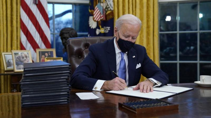 Given the domestic economic pressures and promises made, Mr Biden may well not be able to ease up on the demands being made on India on the trade and economic side (AP)