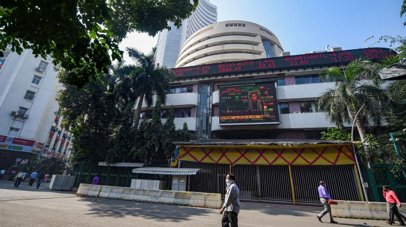 People look at the digital screen on the facade of BSE building, as the sensex crosses 49000 mark for the first time, in Mumbai, Monday, Jan. 11, 2021. (PTI)