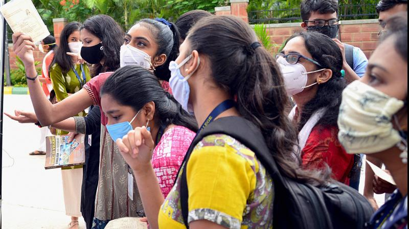 Representational picture shows students checking their hall tickets at an examination centre. (PTI photo)