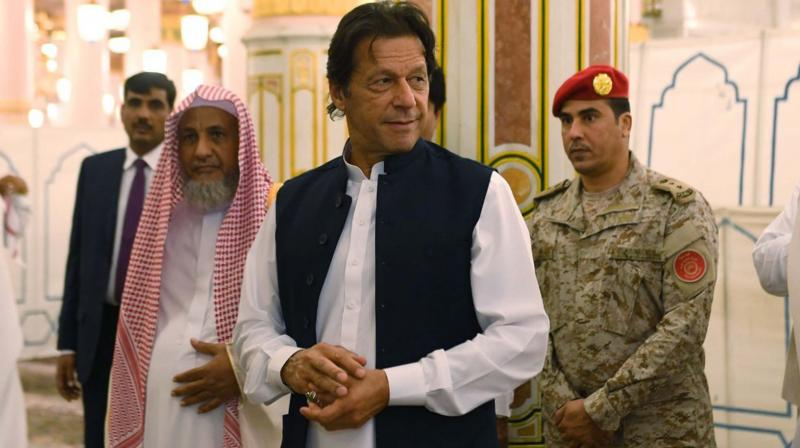 Pakistani Prime Minister Imran Khan visits the Prophet's Mosque in Medina, Saudi Arabia  (Photo: AP)