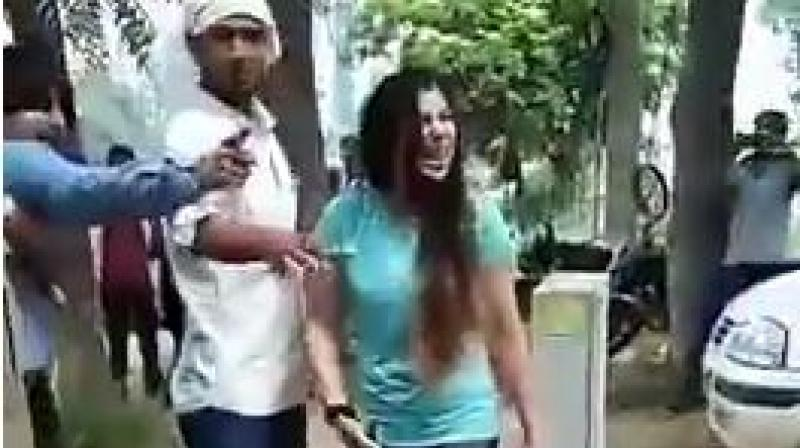 The police said the 28-year-old woman is a chartered accountant and her husband, 32 , is an engineer. The two are residents of a condominium in Sector 90, the police said. (Photo: video screengrab)