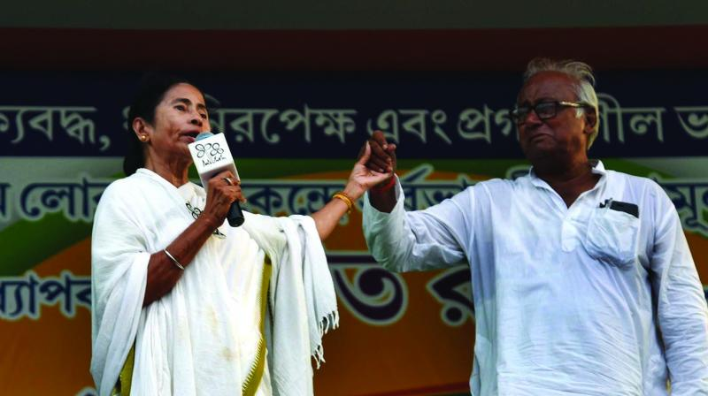 CM Mamata Banerjee with party candidate Sougata Roy at an election meeting in Dum Dum central jail maidan on Saturday. (Photo: Abhijit Mukherjee)