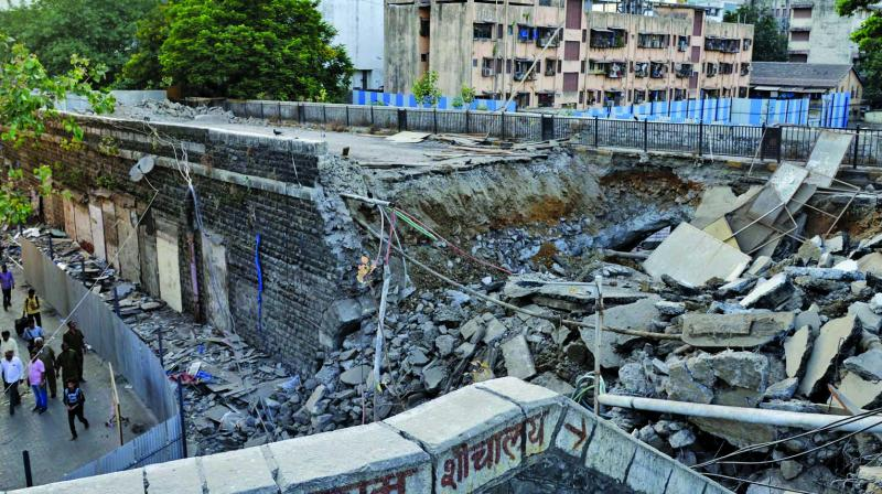 The part of a Lower Parel bridge has been dismantle by Brihanmumbai Municipal Corporation for further reconstruction of the bridge on Sunday. (Photo: Asian Age)