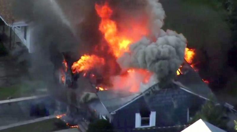 In this image take from video provided by WCVB in Boston, flames consume a home in Lawrence, Mass, a suburb of Boston. (Photo: AP)