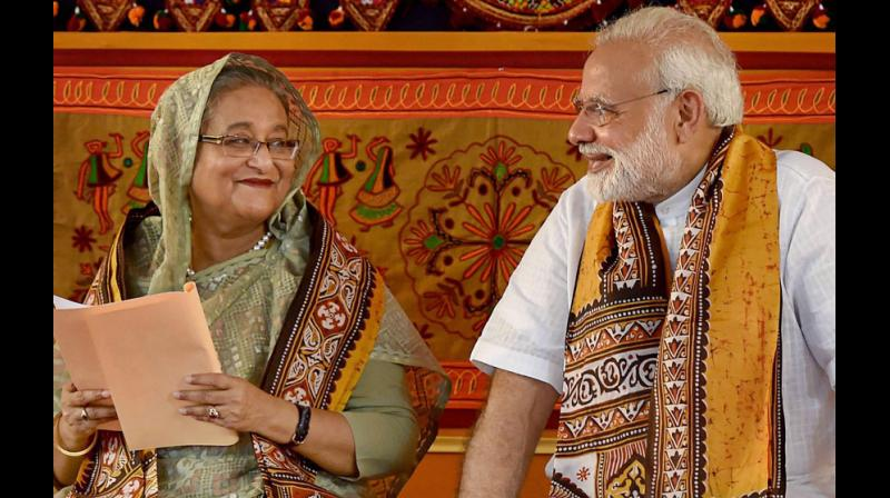 India and Bangladesh this morning inked seven pacts and launched three projects after Prime Minister Narendra Modi held wide-ranging talks with his Bangladeshi counterpart Sheikh Hasina. (Photo: PTI)