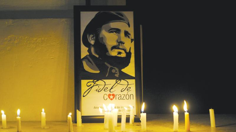 Students light candles in honour of Cuban historic revolutionary leader Fidel Castro a day after his death at the Havana University in Havana on November 26. (Photo: AFP)
