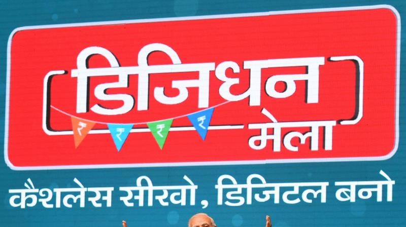 Prime Minister Narendra Modi addressing at the launch of a new mobile app 'BHIM' to encourage e-transactions during the ''Digital Mela'' at Talkatora Stadium. (Photo: PTI)