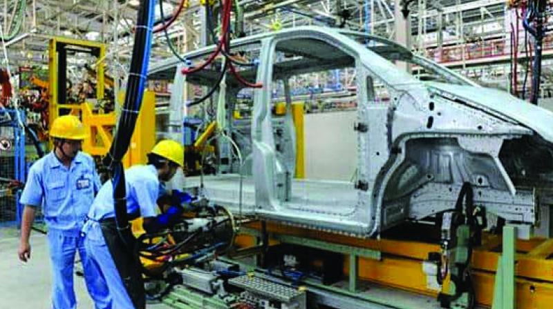 Tata Motors and M&M said on Friday they would cut production at some plants in response to slowing demand.
