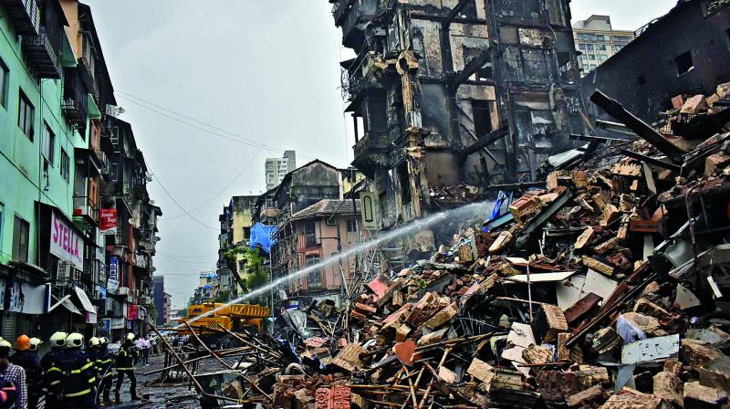 Part of Sayyad building in South Mumbai collapsed on Friday evening, while it was being demolished. (Photo: DEBASISH DEY)