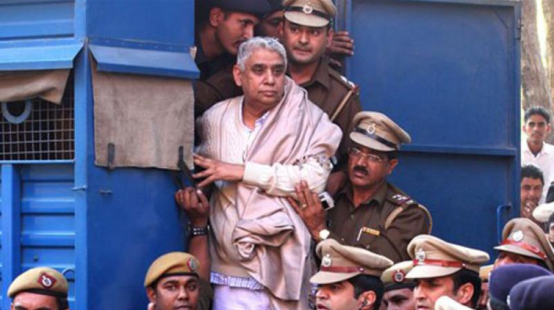 Rampal and 27 of his followers were charged with murder and wrongful confinement after four women and a child were found dead in his Satlok Ashram in Barwala town in Hisar on November 19, 2014. (Photo: PTI)